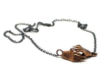 Handmade Holding Hands Necklace in Bronze