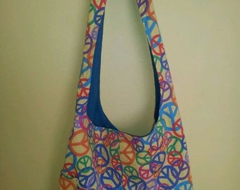 A yellow peace sign hobo/slouch/hip bag