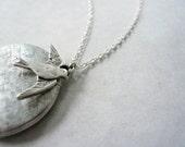 Bird charm locket. Silver locket necklace on sterling silver chain.