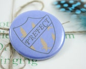 """Ravenclaw Prefect 1.5"""" Pin - Book Colors"""