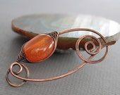 Shawl pin or scarf pin with herringbone wrapped orange Botswana agate stone with a spiral closure