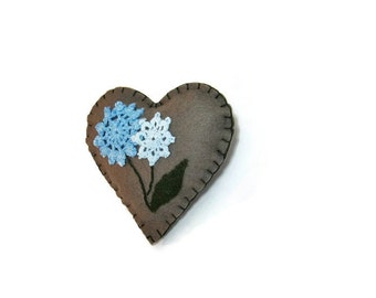 Heart embroidered floral felt blue doilies on olive