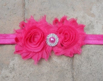 Hot pink shabby flowers with matching pearl rhinestone center on a matching headband newborn-toddler-girls