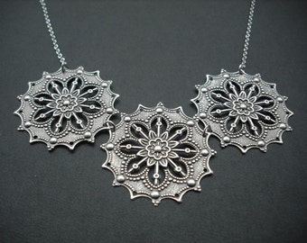star flower stamped necklace