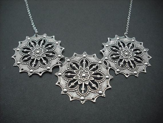 star flower stamped necklace