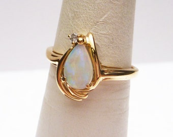 10k Jelly Opal and 2pt Diamond Ring