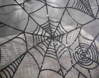 Halloween fabric spiderweb sheer fabric spooky textured spider web fabric.