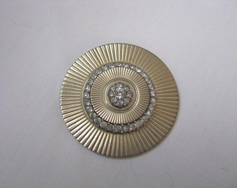 Dramatic vintage gold tone disc brooch pin with rhinestones