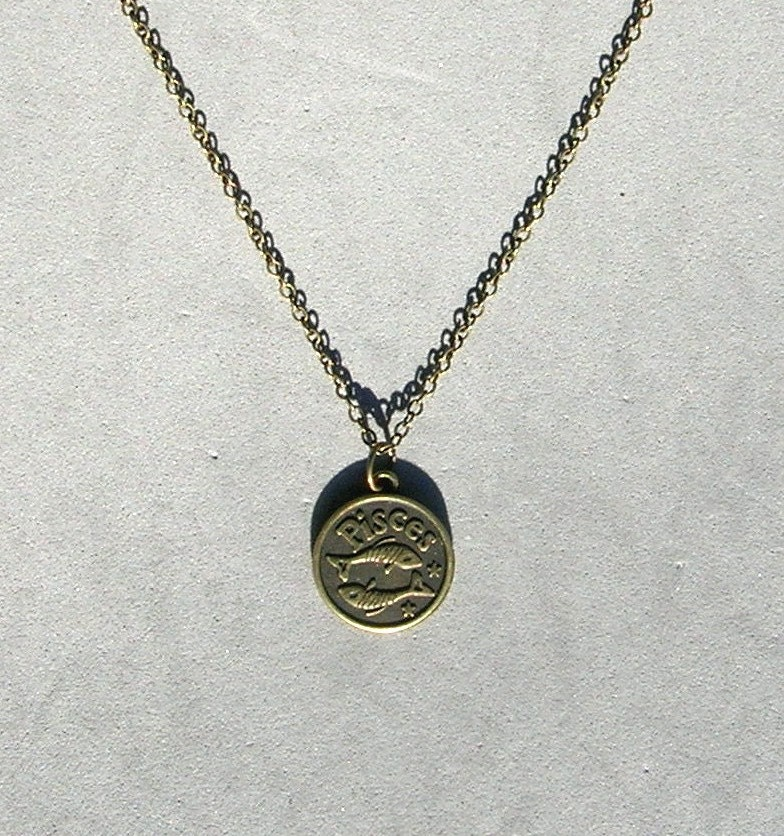 antique bronze zodiac pisces pendant on bronze necklace