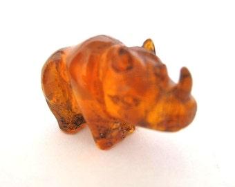 Antique Japanese amber netsuke -A Baby Rhino,signed