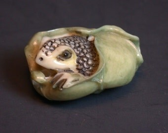 Vintage Japanese bone  netsuke - a baby Frog Wrapped in Lotus Leaf.