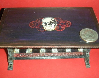 Hand painted haunted skull table with Bespaq base