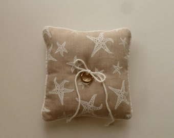 White Sea Stars  on Linen Ring Pillow for Your Coastal Wedding