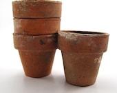 Set of 4 small vintage terra cotta pots