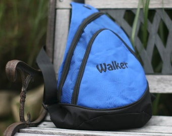 Honeycomb Sling Pack with personalized embroidery.  Includes an audio pocket with headphone exit port!