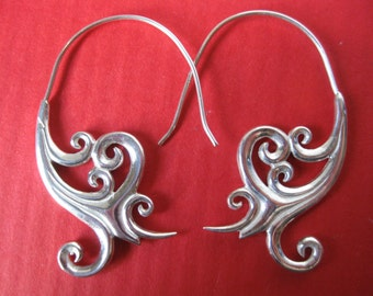 Neo-tribal Maori inspired high-end earrings.  Very unique hand cast hoops.