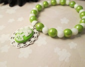 SALE-Green with Envy Lady Death Charm Stretch Bracelet