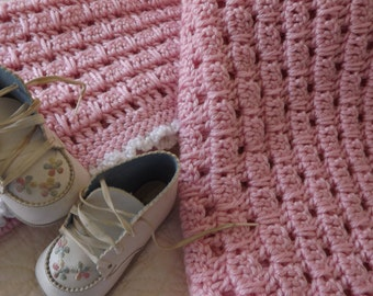 Crocheted Baby Blanket in a Soft Shade of Pink with a White Edge