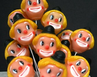 Fun clown faces vintage cake topper. Kids party table setting supply.