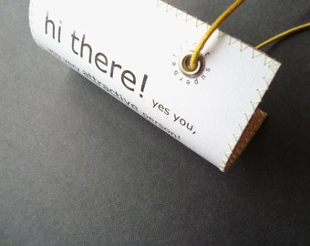 Personalized leather luggage tag that Charms its way Off the Carousel into Your Arms. Camel leather backing. XL