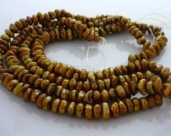 Brassy green center drilled keshi pearls 5-8mm 1/2 strand