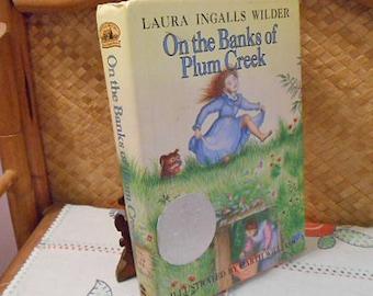 Banks of PLUM CREEK Book Laura Ingalls Wilder 1981, Prairie Adventure Stories, Classic Teen Lit Book, Garth Williams Art Newberry Award hcdj
