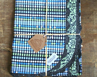 blue green polka dots with a handsome flower design inside-car seat canopy