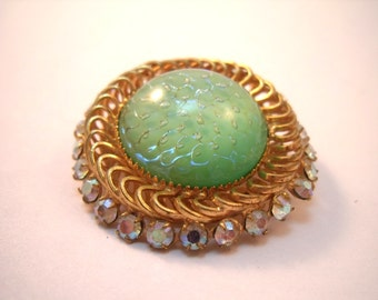 Rhinestone circle brooch with unique art glass center cabochon