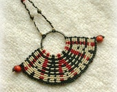 Fashion jewelry macrame necklace in black, white and red , beaded.