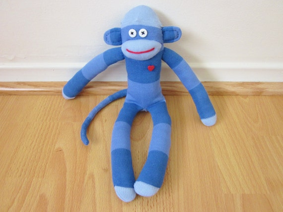 Blue rugby striped sock monkey doll with red heart