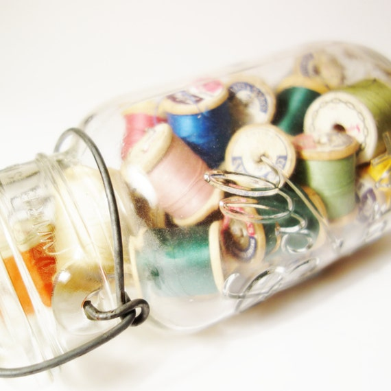 Vintage ball jar with wooden spools from Zomalee Vintage