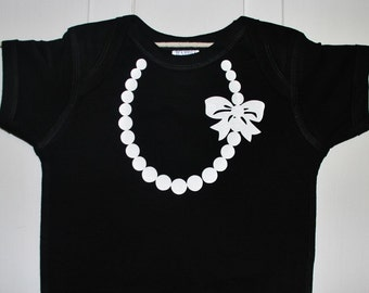 The Carrie Pearl Necklace with Bow on Black Bodysiut with SILVER Pearls and Bow