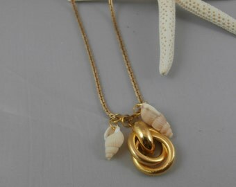 Gold Sailor's Knot and Sea Shell Charm Necklace