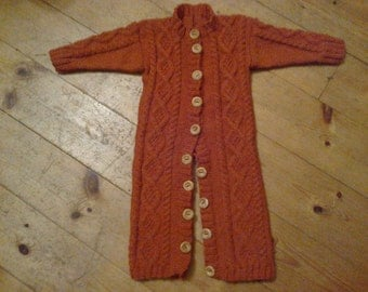 FREE POSTAGE  - Handknitted cable all in one suit with button fastening.