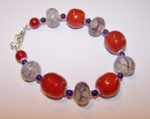 Glass and agate bracelet  Orange purple and grey beads