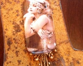 Beautiful Vintage Belly Dancer Glass and Crystal Pendant Necklace..burlesque, showgirl, vaudeville