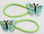 Green Ponytail Holder with Beautiful Blue Butterfly with Green Glitter Wings and Brown Body
