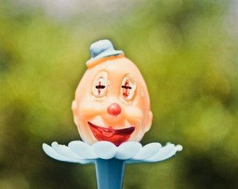 eleven clown cupcake toppers .. large and small, red yellow blue