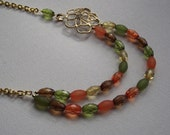 Gold Filigree Flower Charm Necklace with Double Strand of Brown Orange Yellow and Green Resin Beads