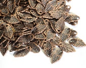 25 small copper metal leaves 15mm x 8mm
