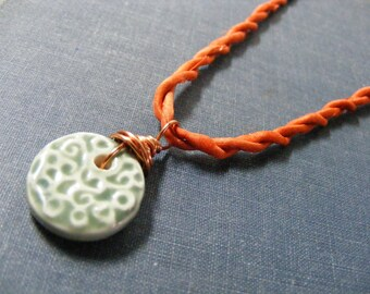 Soft Sage Green Swirls Pendant and Orange Twisted Silk and Copper Necklace