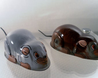 Vintage Pair of Tin Plate Friction Toy Mice. White & Brown, Hero Toys, Japan Hallmark.  5.5 Inches Length w their Tails. Good Condition.
