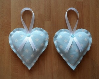 A pair of handmade decorative, hanging, padded hearts. Cath Kidston Stars cotton fabric in baby blue and white.