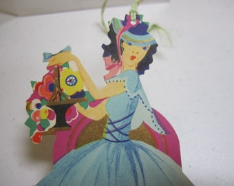 1920's-30's unused die cut gold gilded art deco P.F.Volland bridge tally lady in blue dress, hat and shoes holding basket of  flowers