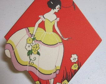 Colorful art deco 1920's-30's die cut unused diamond shaped bridge tally pretty lady in billowy gown picking flowers in a  garden