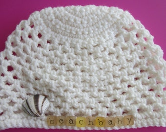 White crochet beanie for a beach baby with seashell fits 9-18 mos.