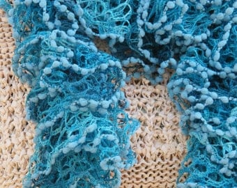 Scarf, shades of blue in a frilly lacy ruffle wool yarn 54 inches in length,