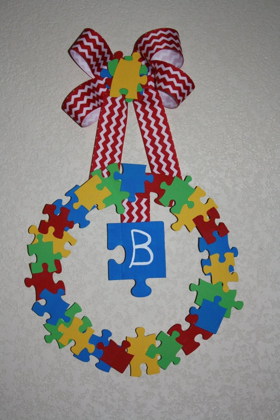 Items similar to autism awareness puzzle wreath on etsy for Craft ideas for autistic students