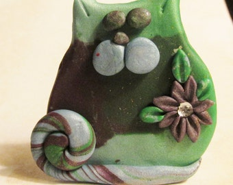 """Emerald is a cute little pocket Kitty in brown and green polymer clay 2"""" tall"""