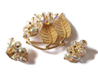 Aurora borealis cluster brooch and clip earrings crystal leaves with rhinestones provide elegant night wear or great for a wedding